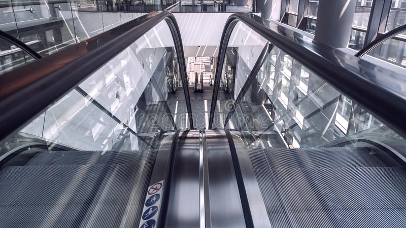 Moving escalator in interior of office building royalty free stock images