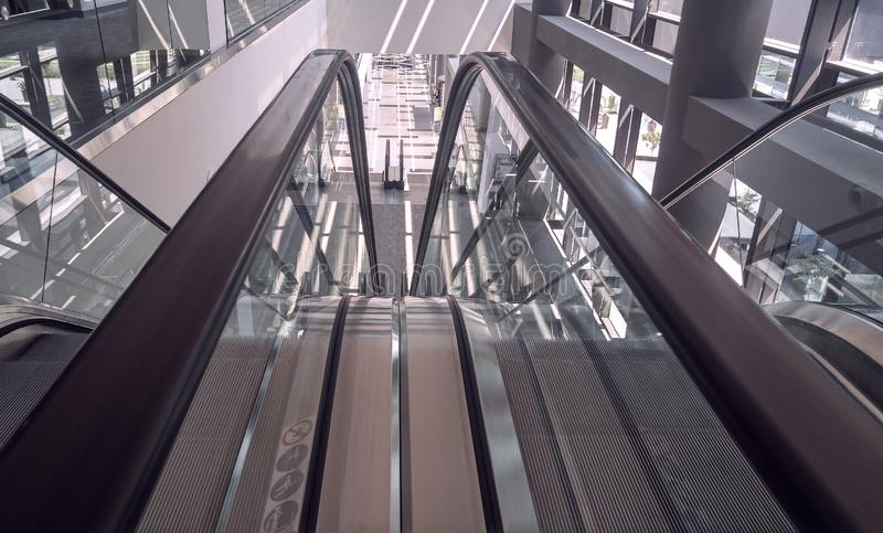 Moving escalator in interior of office building stock photography