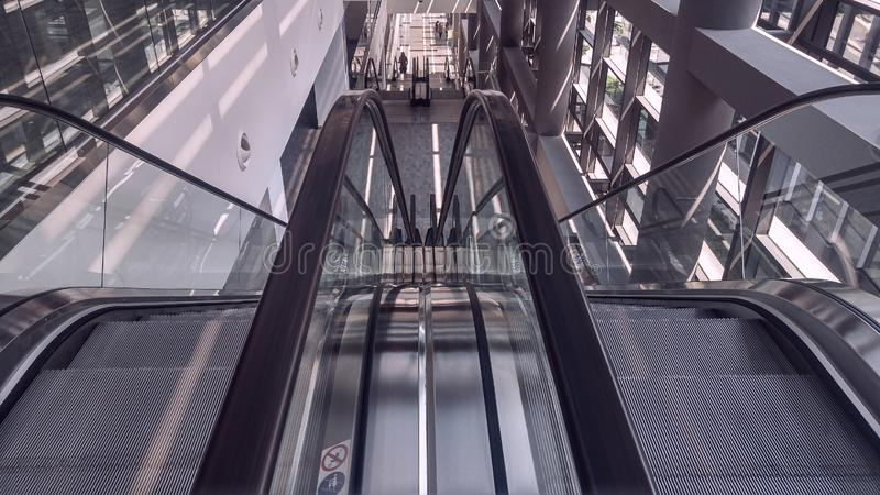 Moving escalator in interior of office building stock images