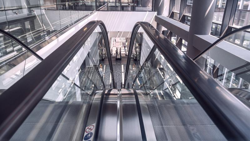 Moving escalator in interior of office building royalty free stock photo