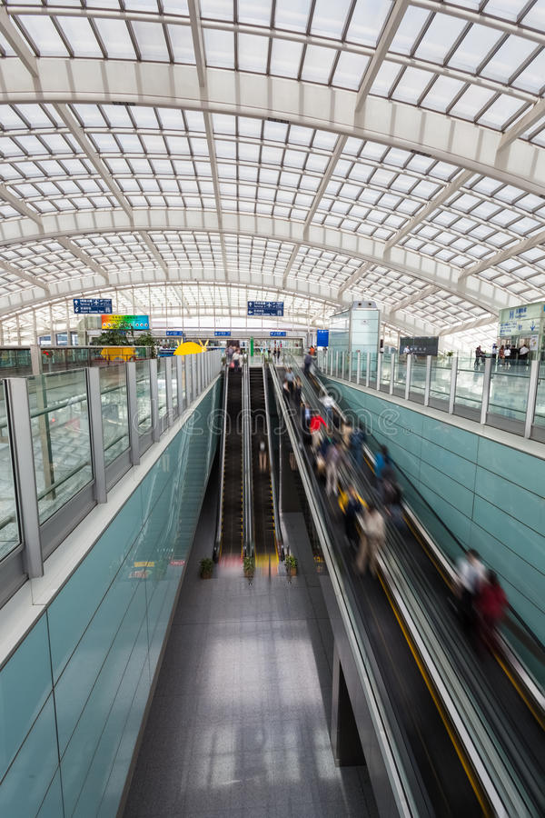 Moving escalator within the modern airport hall. Beijing , China stock image