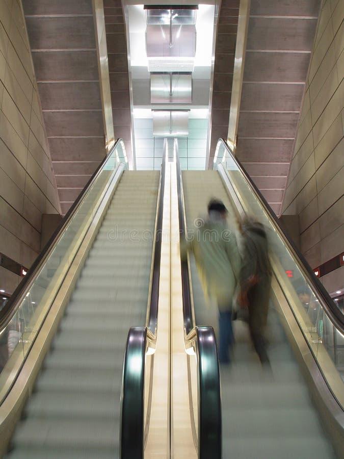 Download Moving escalators stock image. Image of down, upwards, couple - 15447