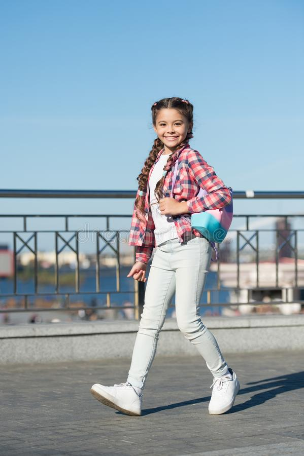 Moving with the fashion. Fashion look of small vogue model outdoor. Adorable girl of fashion on summer day. Fashionable royalty free stock image
