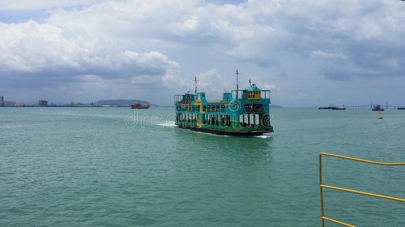 Moving ferry in Penang, Malaysia royalty free stock photography