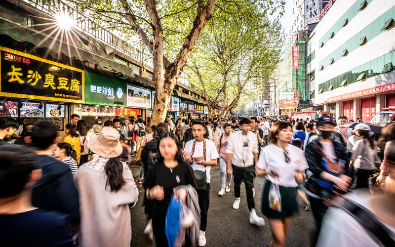 Moving forwad crowd of Chinese people in streetfood street in Wuhan Hubei China stock photo