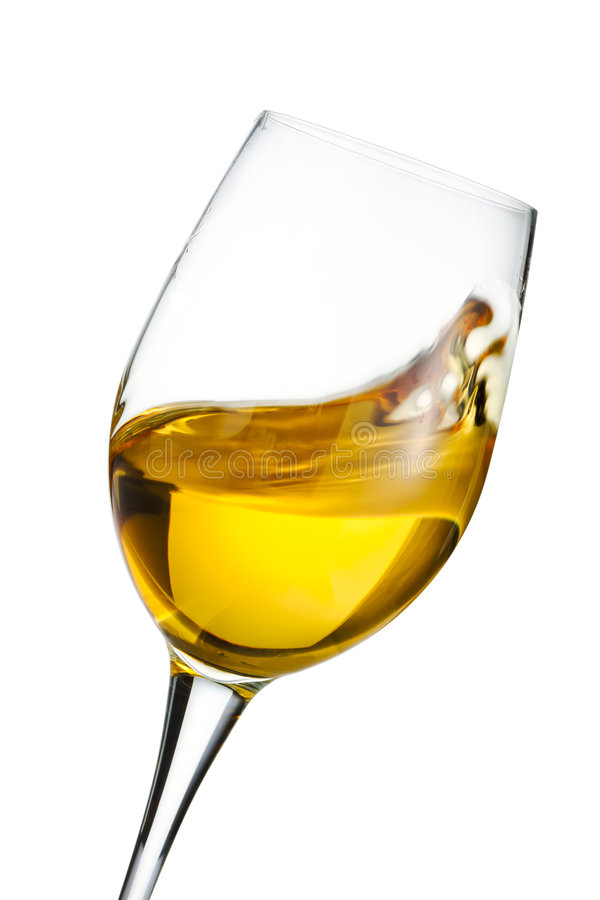 Moving glass of white wine stock image