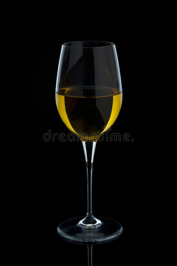 Moving glass of white wine stock images