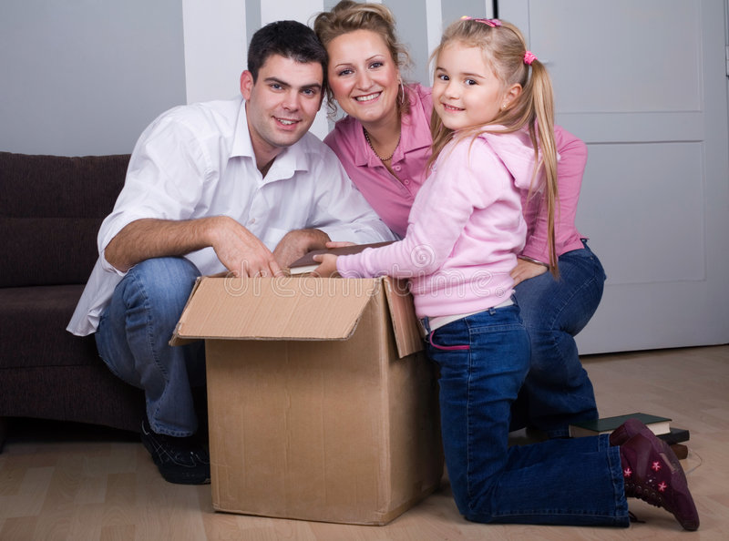 Moving house. Young family moving house, real estate concept stock images