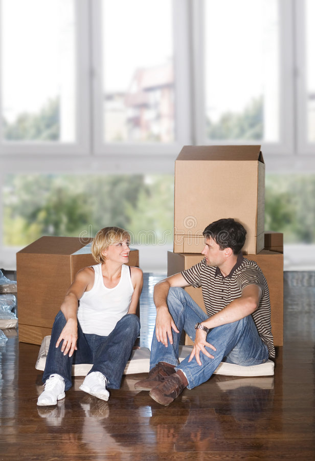 Moving house. Young couple in love moving house royalty free stock image