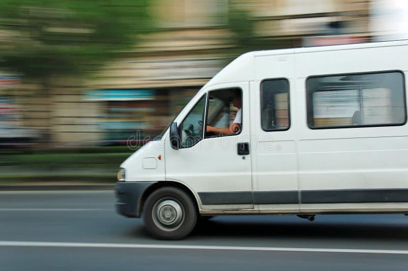 Moving minibus stock images