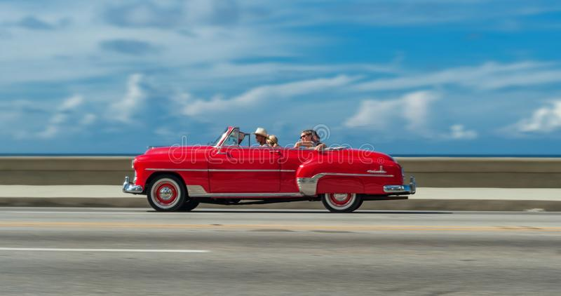 HAVANA, CUBA - OCTOBER 20, 2017: Moving Old Car in Malecon, Havana. Cuba. Sightseeing Tour with Tourist royalty free stock photography