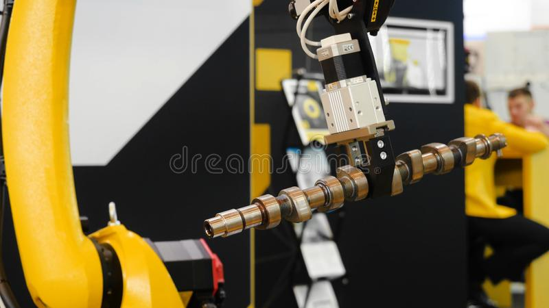 Moving part of robotic arm machine tool. Media. Robotic arm uses a billet item for work.  stock images