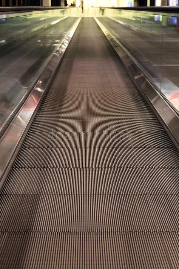 Moving sidewalk in airport stock image