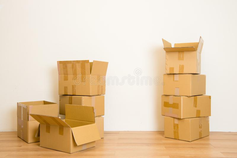 Moving in Stack of cardboard boxes royalty free stock images