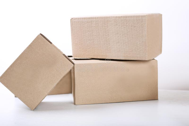 Moving in. Stack of cardboard boxes on white background. Close up royalty free stock photos