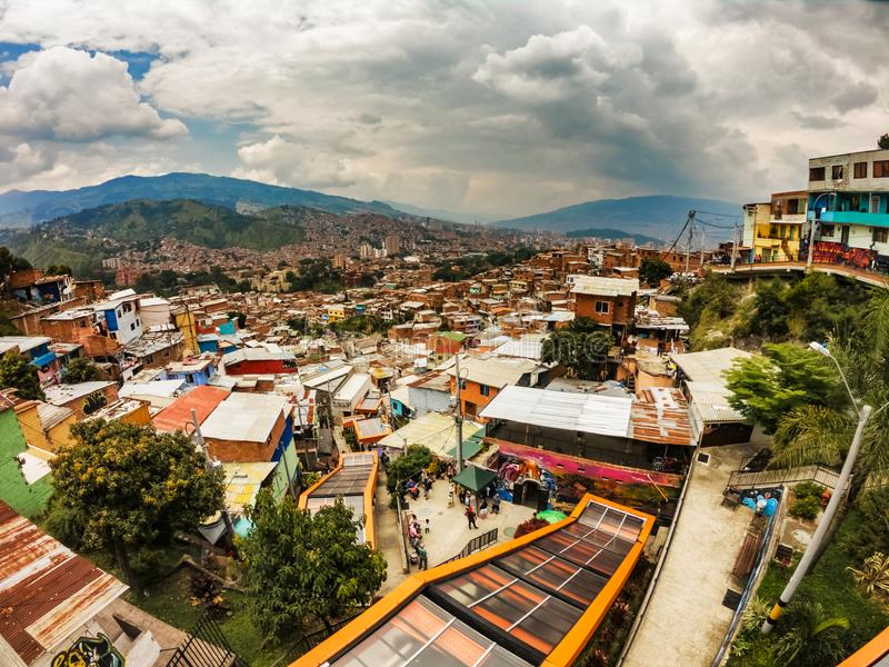 Moving stairs in Comuna 13, Medellin, Colombia. Moving stairs and the landscape view over Comuna 13 the district of Medellin, Colombia stock photo