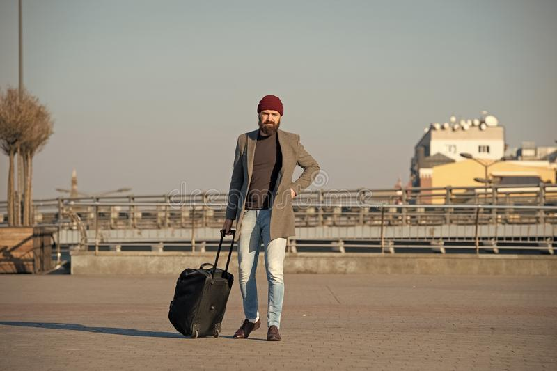Moving to new city alone. Hipster ready enjoy travel. Carry travel bag. Man bearded hipster travel with luggage bag on royalty free stock photography