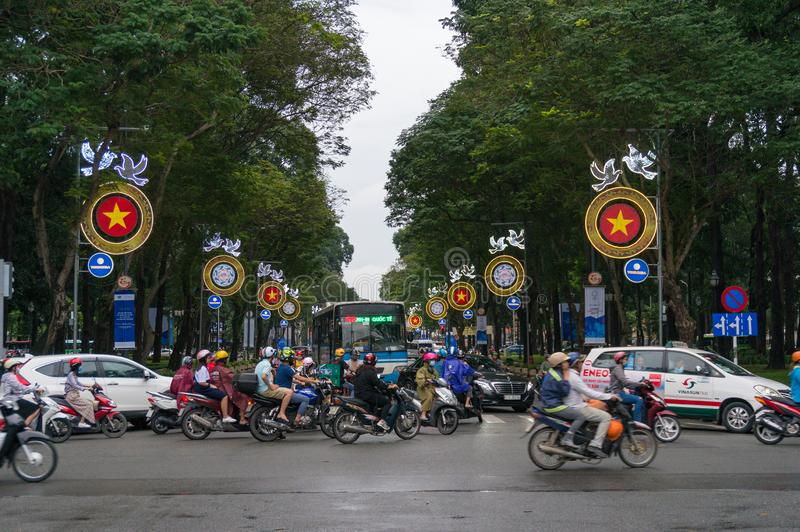 Moving traffic crossing the street during rush hour in HCMC in Vietnam. Ho Chi Minh City, Vietnam - August 23, 2017: Moving traffic crossing the street during stock image