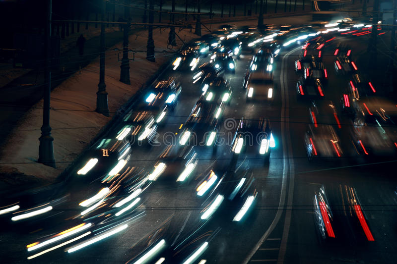 Moving traffic at night with moving lights. At winter; many cars royalty free stock photos