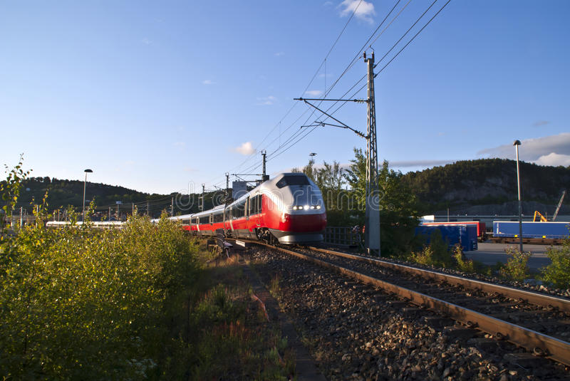 Moving train. Train at full speed on their way from Halden railway station to Oslo main railway station royalty free stock photos