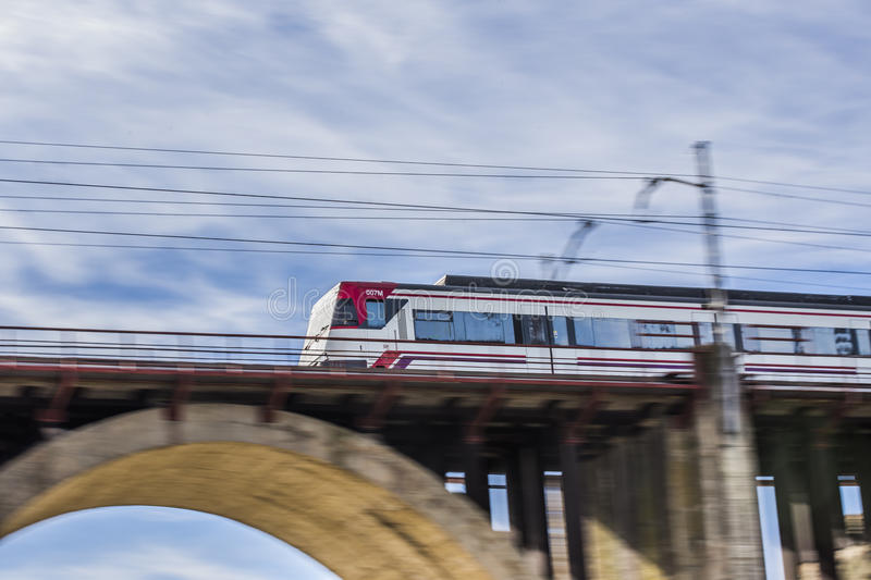 Moving train on a bridge stock photos