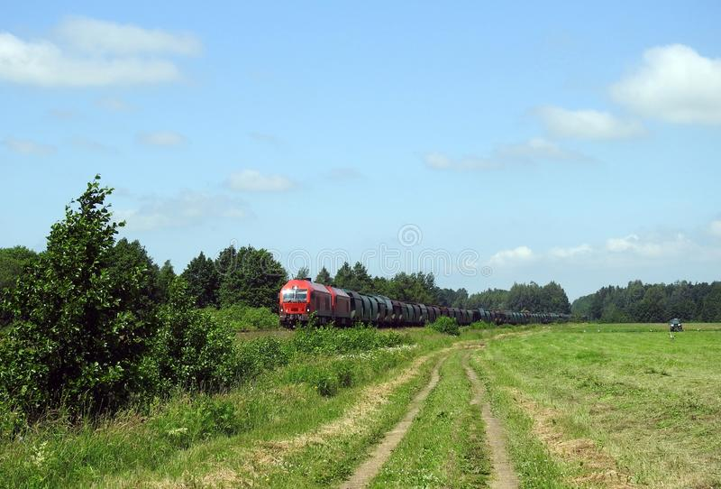 Moving train , field and stork birds, Lithuania stock images