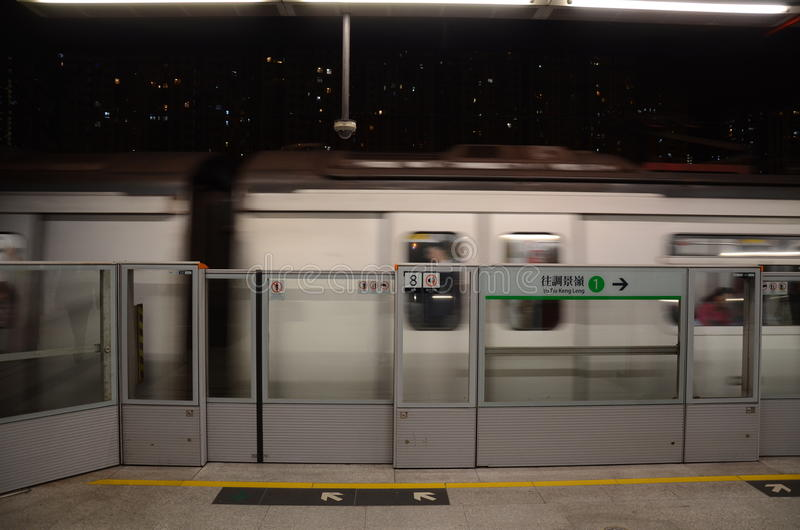 Moving Train on Hong Kong MTR Platform royalty free stock images