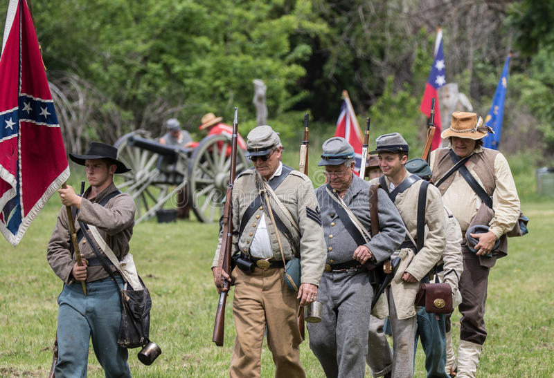 Moving up to Fight. Civil War era soldiers in battle at the Dog Island reenactment in Red Bluff, California stock images