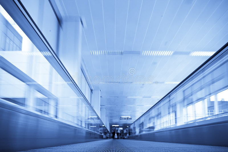 Moving in walkway stock image