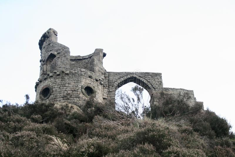 Mow Cop Castle or Folly, Stoke-on-Trent. The Mow Cop folly stands roughly 400m above the see level. It looks like ruins of a really old castle, and the ruins are royalty free stock photo