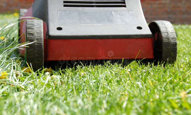 Mower in grass stock image