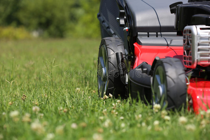 Mower. Lawn mower on the grass during the summer day stock photography