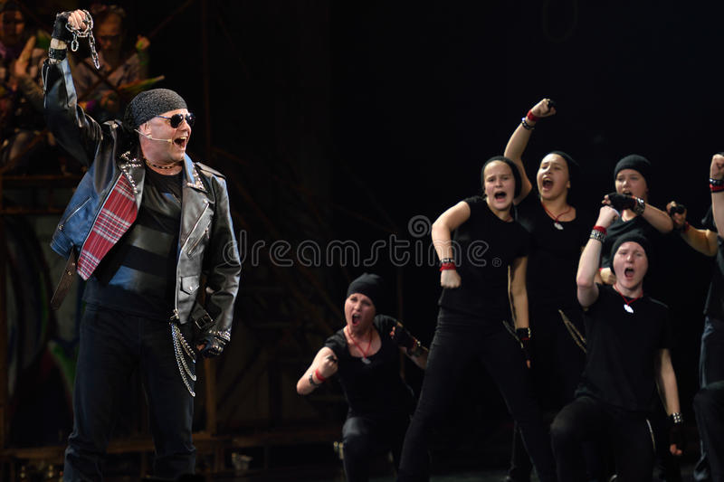Mowgli Generation the musical at SPIEF 2015. St. Petersburg, Russia - June 19, 2015: Singer Alexey Kortnev performs in a scene from a children's charity project stock images