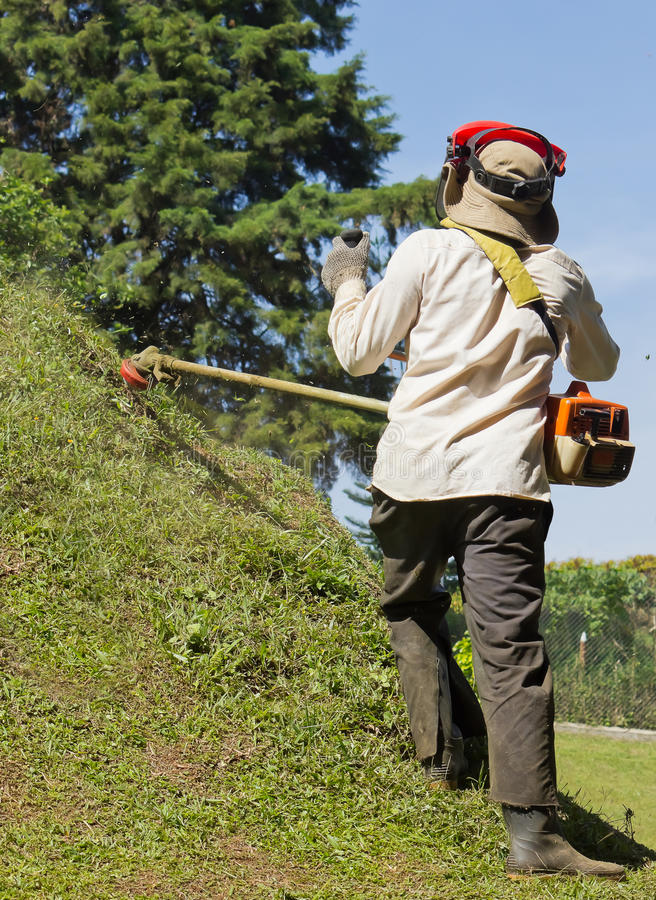 Mowing the Lawn of Hill royalty free stock photos