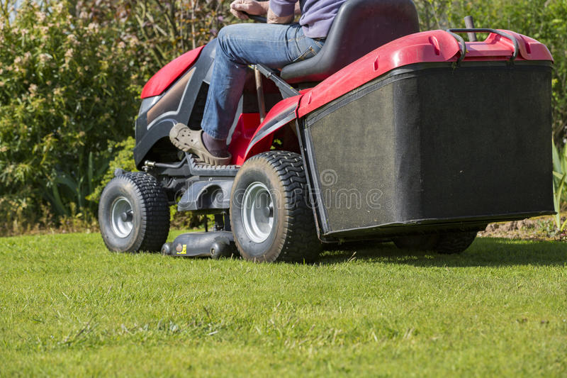 Mowing the lawn with tractor stock photo
