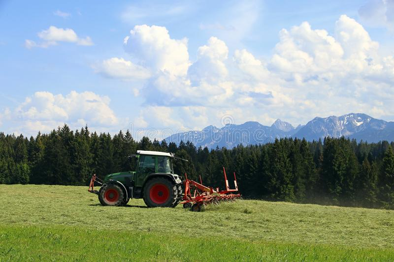 Mowing in summer on a field in Bavaria stock photos