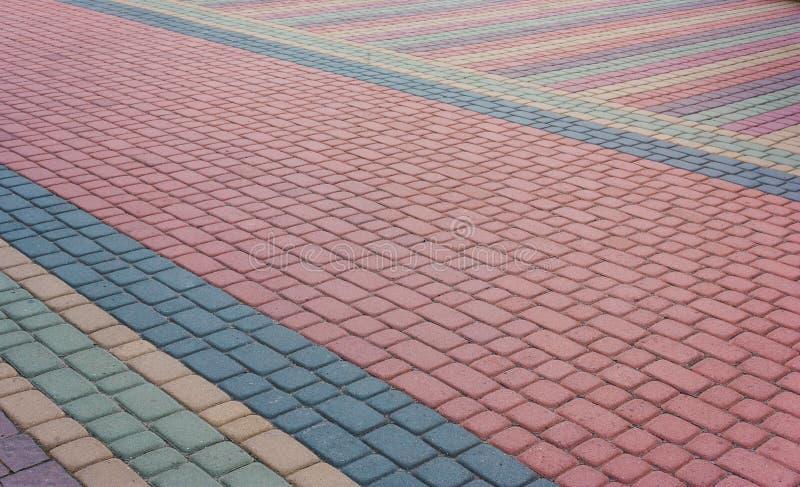 Mozaïek van kleuren modieuze moderne straatstenen De weg van de stadssteen royalty-vrije stock foto