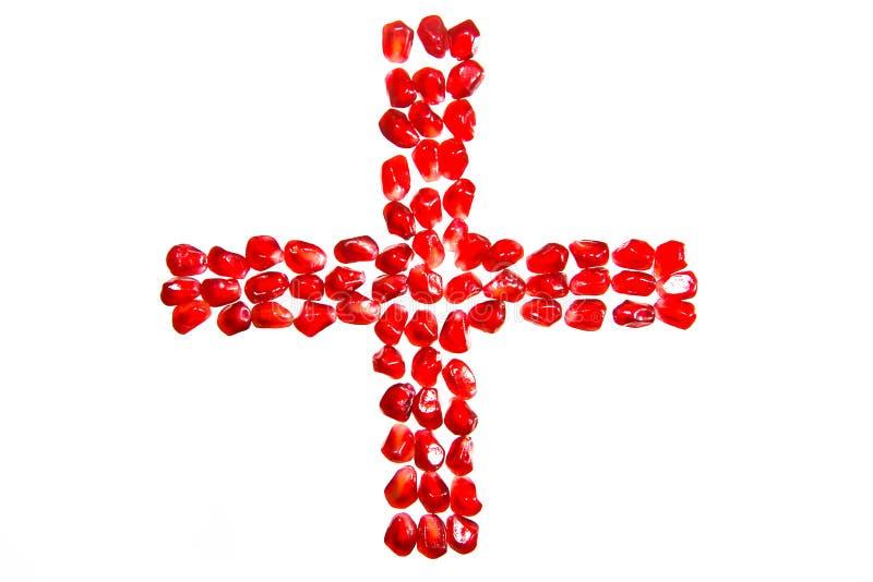 Mozaïeken van granaatappelkorrels worden gemaakt in de vorm van het Rode Kruis dat royalty-vrije stock foto's
