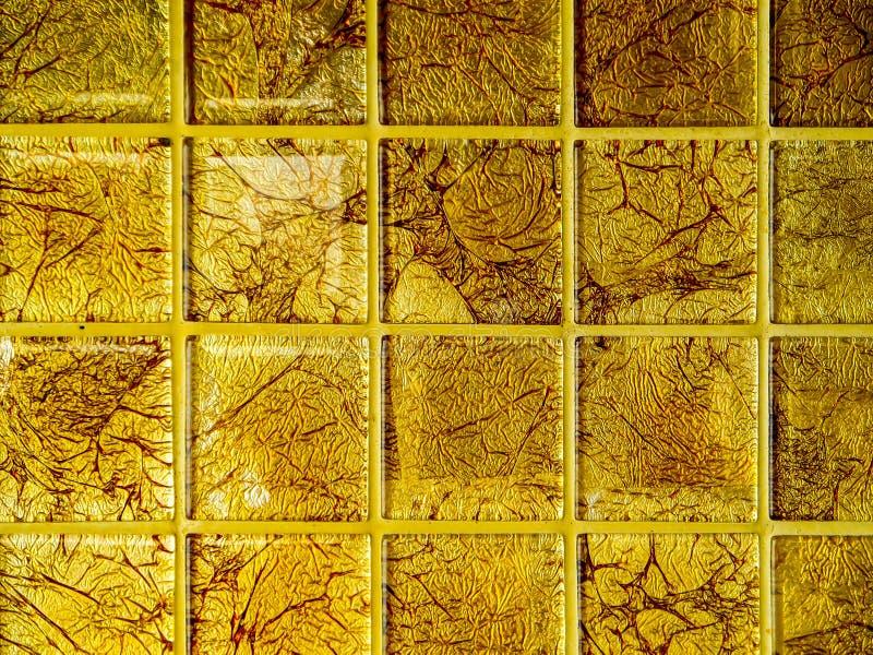 Mozaiki złota kwadratowego bloku tapety luksus obrazy stock