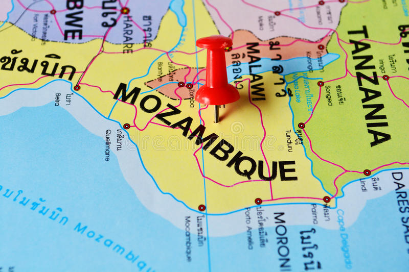 Mozambique map. Macro shot of mozambique map with push pin stock photos