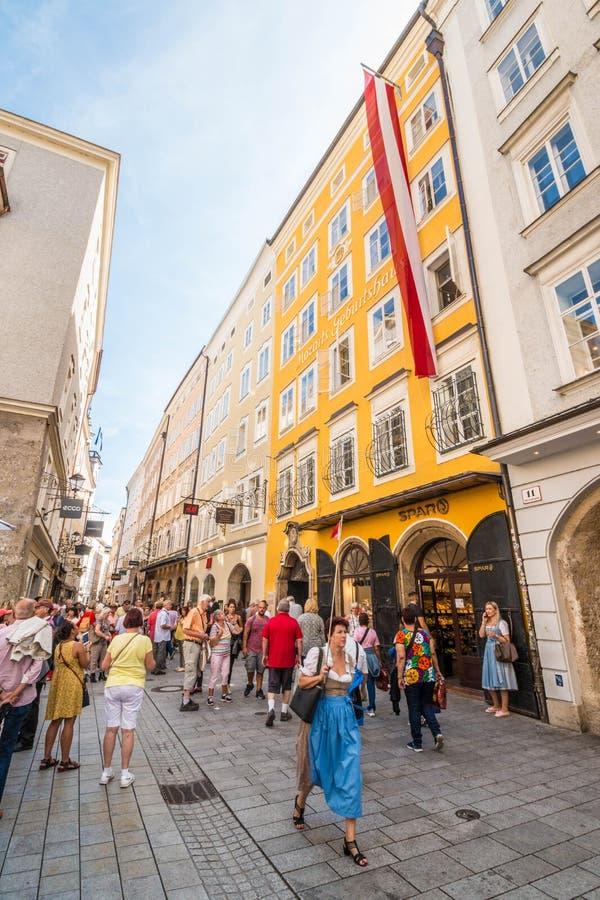 Mozart`s Birthplace house on busy popular shopping street Getreidegasse, Salzburg, Austria stock images