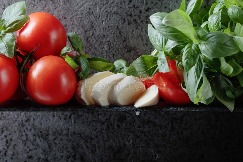 Mozzarella with basil and tomatoes stock photos