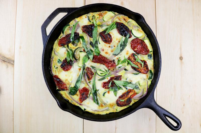 Mozzarella, Basil & Zucchini Frittata in Cast Iron royalty free stock photos