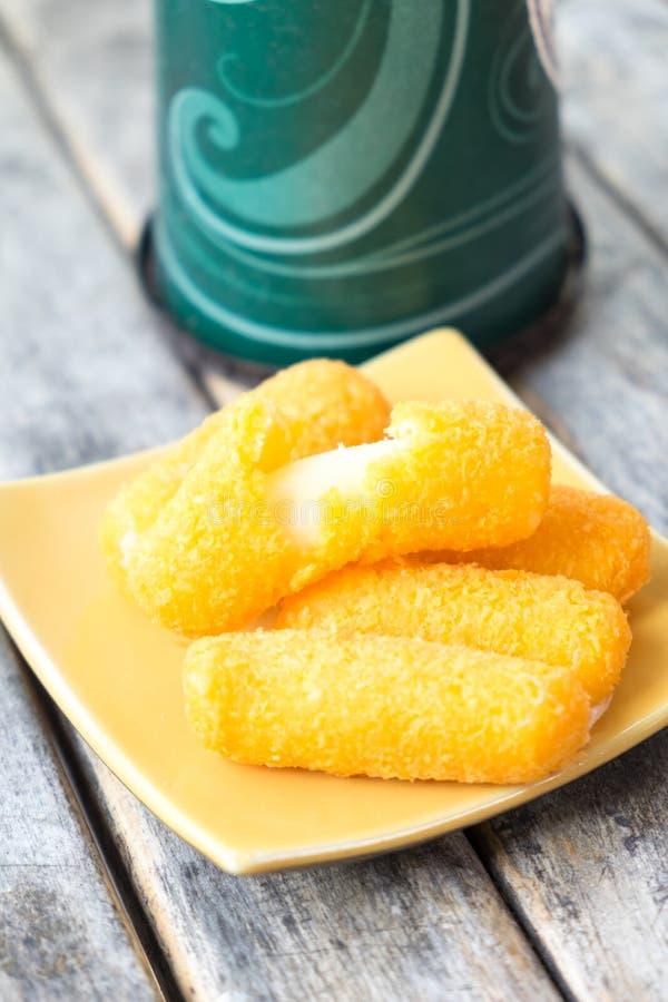 Mozzarella cheese sticks breaded stock image