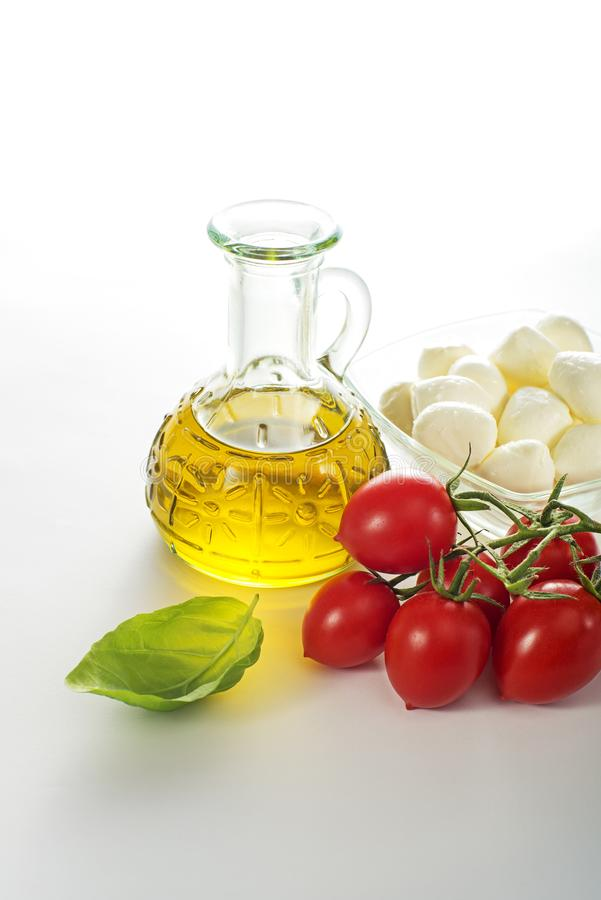 Mozzarella cheese with tomato and olive oil stock photos