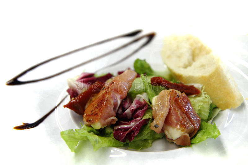 Mozzarella grilled in the pig ham as gourmet food background royalty free stock photography