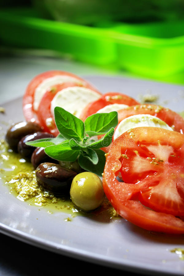 Mozzarella salad. Salad with tomatoes olives and cheese stock photo