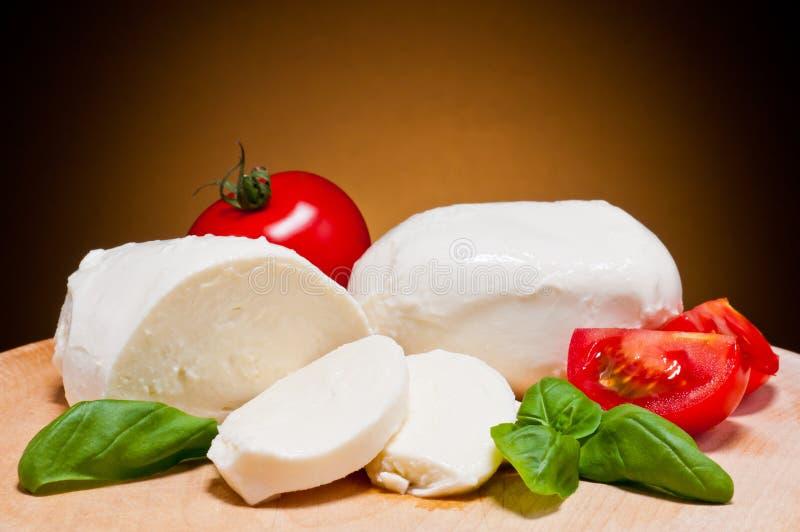 Mozzarella, tomatoes and basil royalty free stock photography