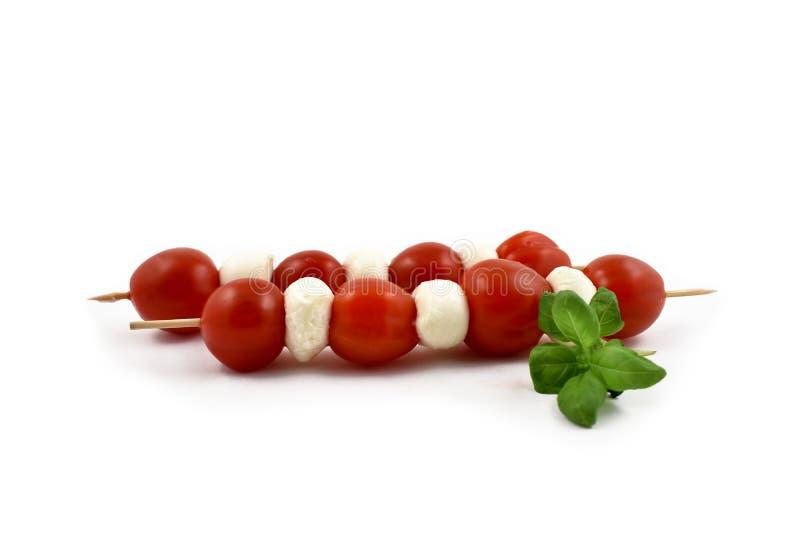 Mozzarella z pomidorów akcyjnymi wizerunkami zdjęcie royalty free