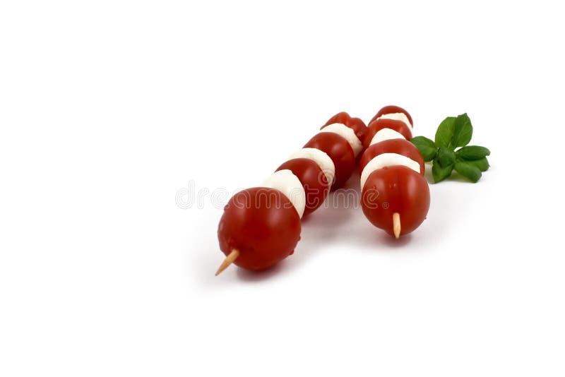 Mozzarella z pomidorów akcyjnymi wizerunkami obraz royalty free